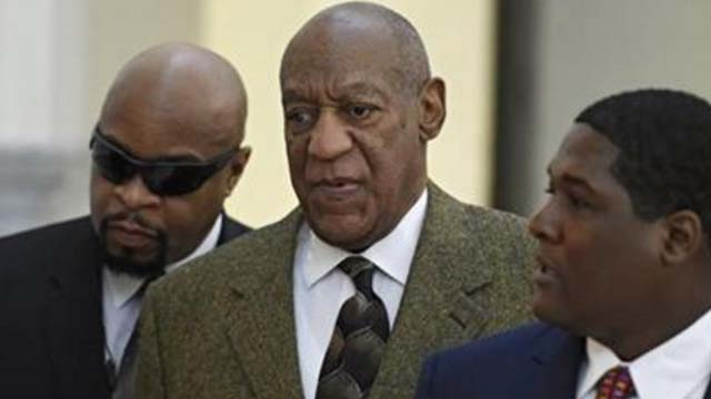 Actor and comedian Bill Cosby, center, arrives for a court appearance Tuesday, Feb. 2, 2016, in Norristown, Pa. Cosby was arrested and charged with drugging and sexually assaulting a woman at his home in January 2004.
