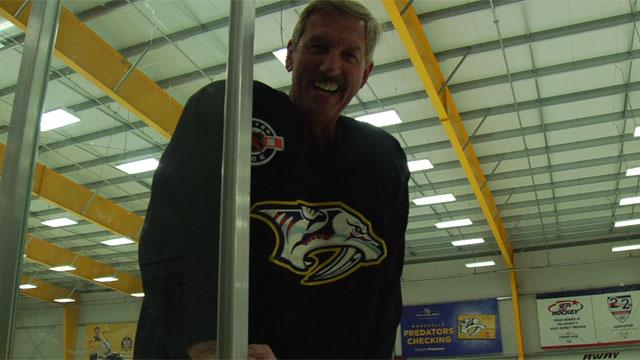 Bob Mueller plays hockey_441944