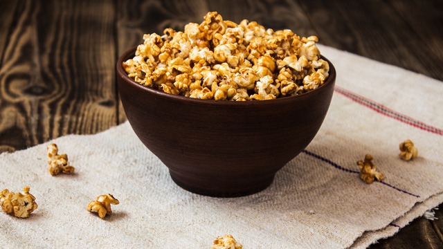 caramel popcorn in the bowl wooden background_455152