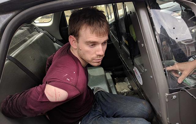 Travis Reinking in police car_1524509794600.jpg.jpg