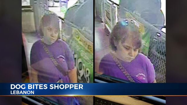 woman wanted after service dog bites shopper.JPG