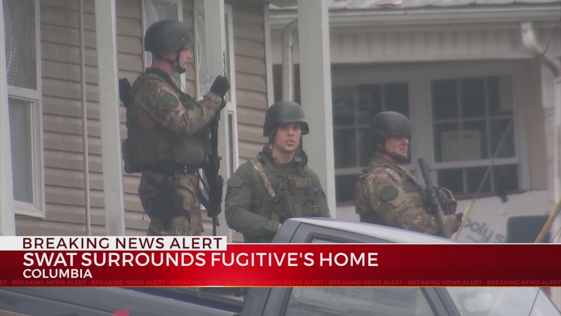 SWAT Team surrounds fugitive's home