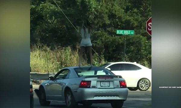 Antioch woman dances on car