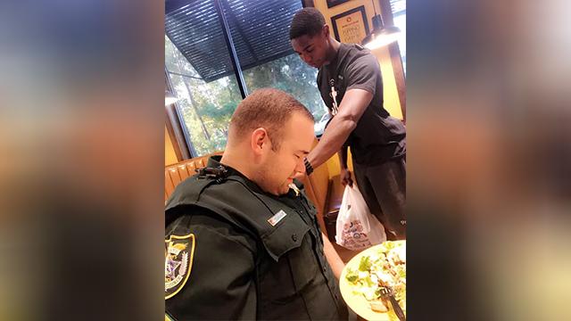 praying over deputy