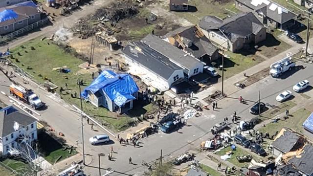 tarps over homes tornado damage