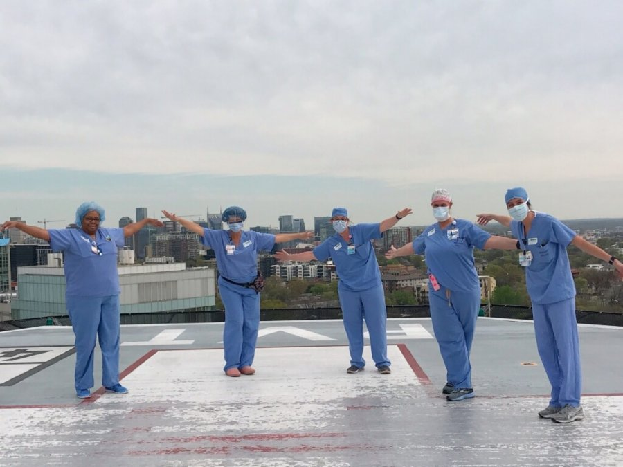 Staff prays on Vanderbilt's helipad