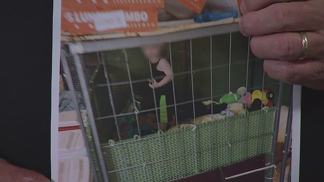 Henry County toddler in cage