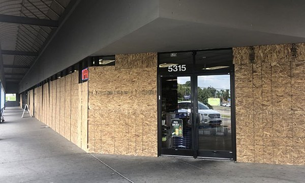 Boarded up windows at The Shoppes at Hickory Hollow