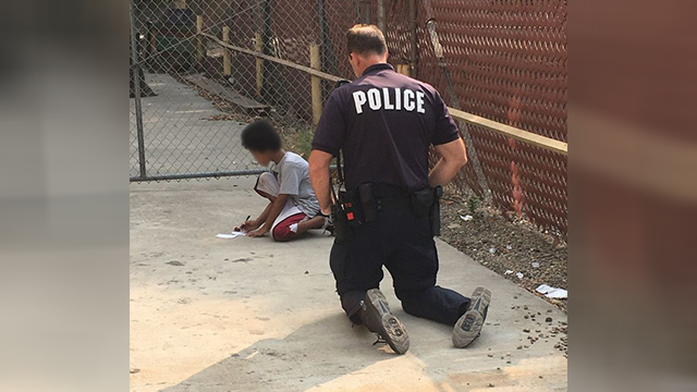 Officer helps child
