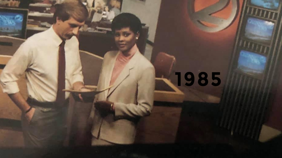 1985: Pre-newscast discussion with long-time co-anchor Anne Holt