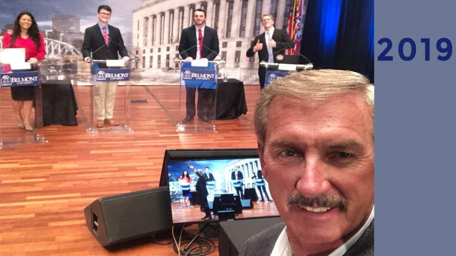 2019: Bob guiding newsroom interns practicing for the Mayoral Debate