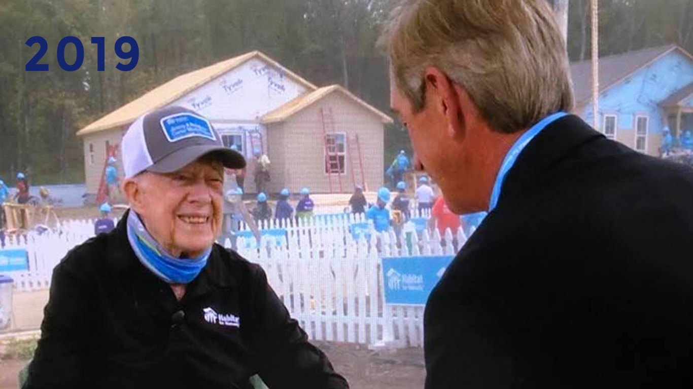 2019: Bob interviews Fmr. President Jimmy Carter while the Carter Work Project progresses in the background