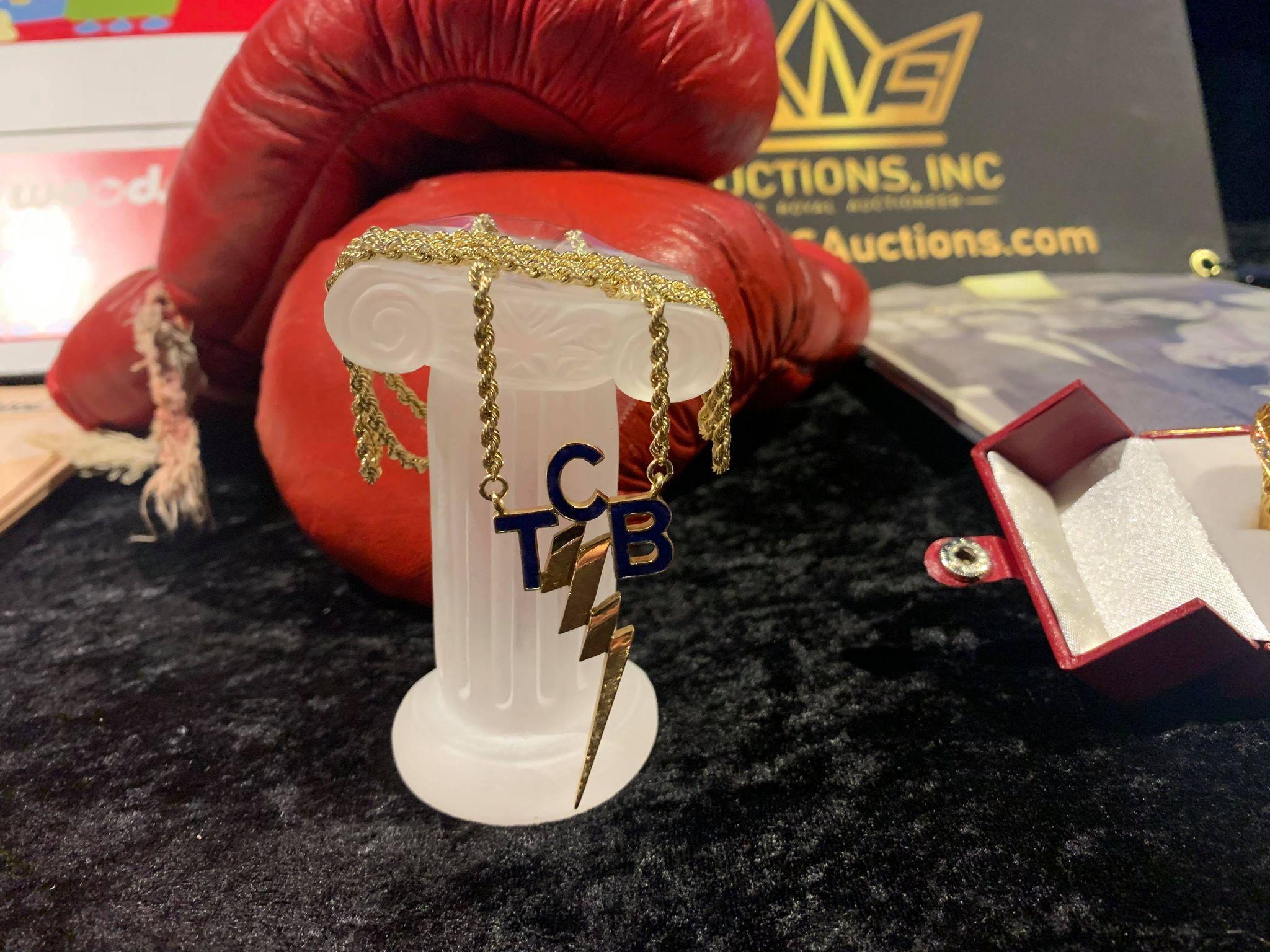 Kruse GWS Auctions: Elvis Presley TCB Necklace