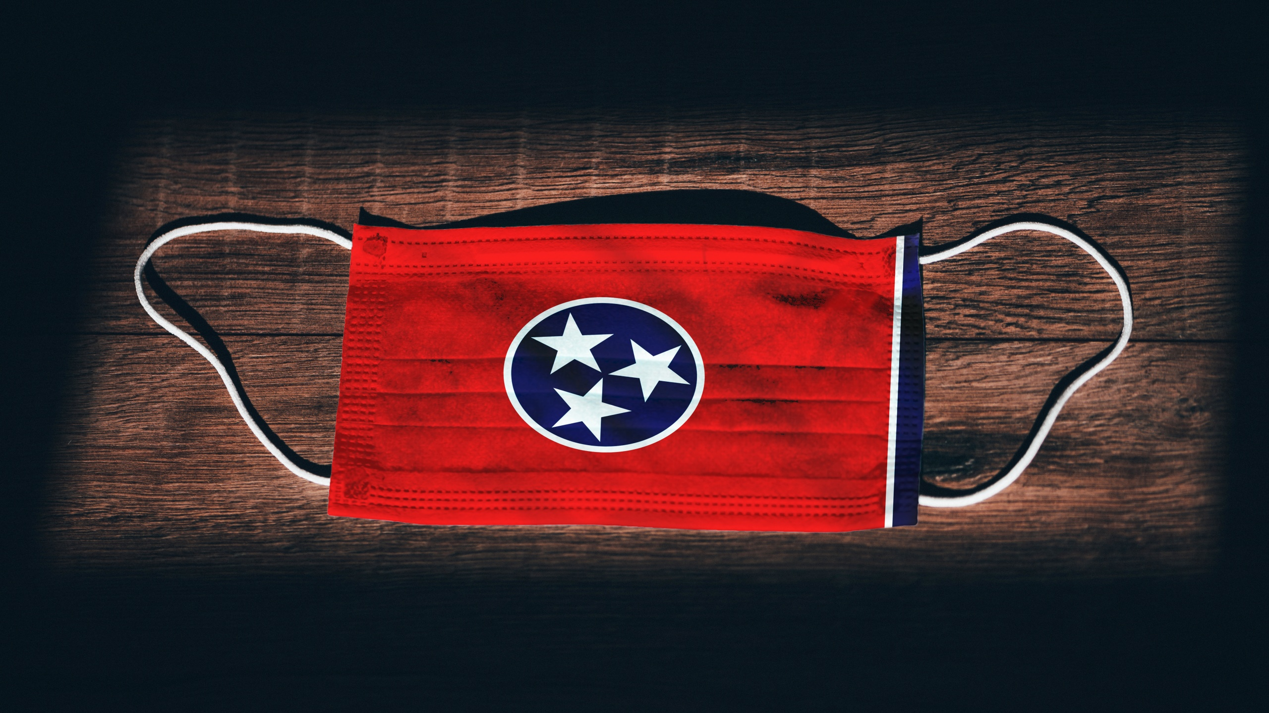 Tennessee Flag. Coronavirus Covid 19 in U.S. State. Medical mask isolate on a black background. Face and mouth masks for protection against airborne infections in USA, America