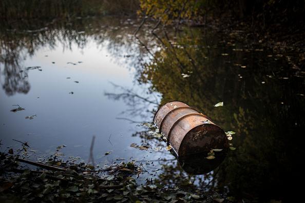 barrel trash in water